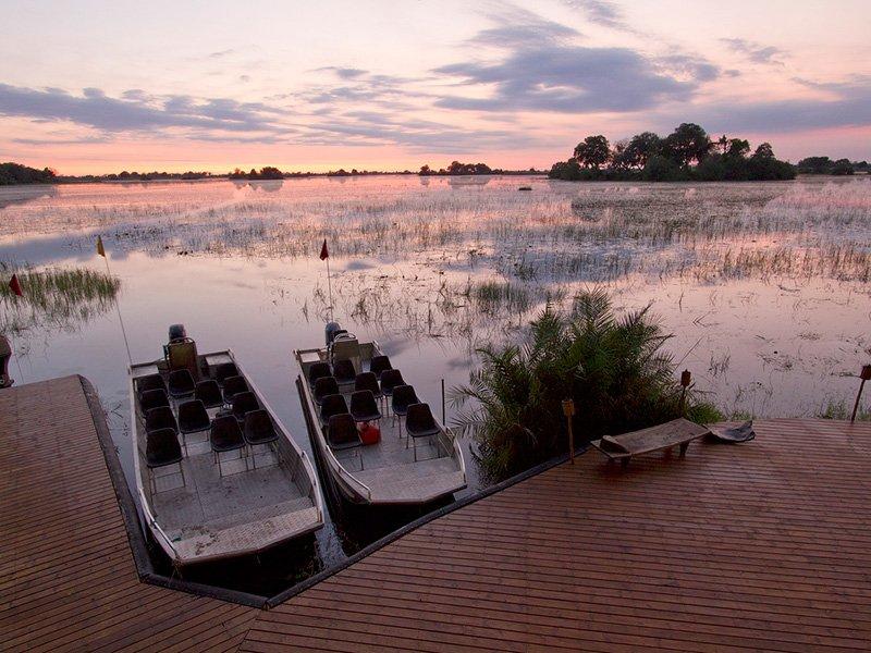 Botswana-Okavango-Jacana-Camp-BoatSunset